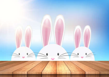 easter background with cute bunnies looking over a wooden table