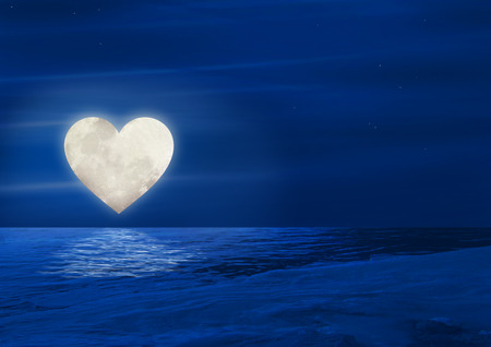 Heart moon reflecting over water Stock Photo