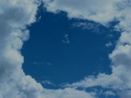 Frame of Clouds- Blue Skies With a White Frame Formed by Clouds Stock Photo