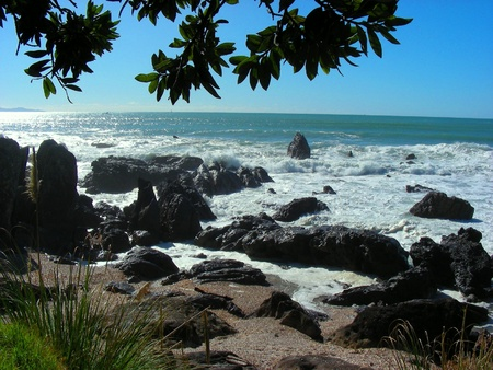 Beautiful Sunny Day on a Rocky Beach, Tauranga, New Zealand Stock Photo