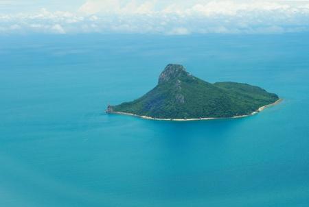 A Lone, Uninhabited Island in the Ocean- Bird`s-Eye View