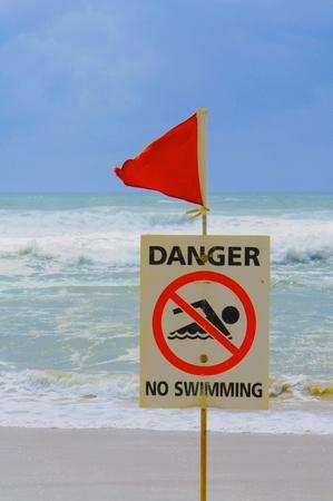 no swimming sign: Danger No Swimming Sign on the Beach, Gold Coast, Australia