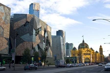 MELBOURNE, AUSTRALIA - JULY 2, 2011 : Melbourne - The Modern and the Historical. Australian Centre for the Moving Image, Eureka Tower, Flinders Street Station