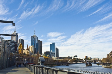 Melbourne Skyline with Sandridge Bridge - Symbol of Australian Immigration