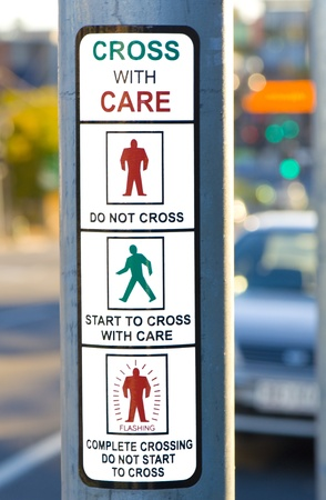 Cross With Care Sign at Traffic Lights