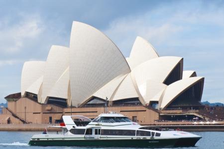 Sydney, Australia, July 17, 2011 - Cruise Boat Passing Sydney Opera House Building