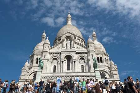 Paris, France, August 16, 2011 -  Tourists visiting the Basilica of the Sacred Heart of Jesus of Paris ( Sacré-Cœur) Closeup Stock Photo - 10435301
