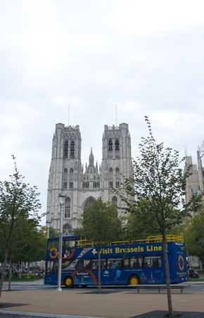 Brussels, Belgium, August 18, 2011 - Brussels Tourist bus in front of the St. Michael and St. Gudula Cathedral