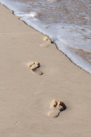 Waves Washing Away Footprints in Sand