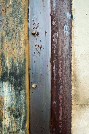 Industrial Background with Rusty Metal and Two Bolts