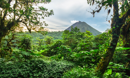 Volcan Arenal rises out of the jungle and dominates the landscape near the town of La Fortuna, Costa Rica.