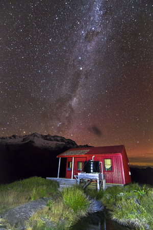 Stars and the Milky Way Galaxy are visible above Liverpool Hut in the Matukituki Valley, Mt. Aspiring National Park, south island of New Zealand.