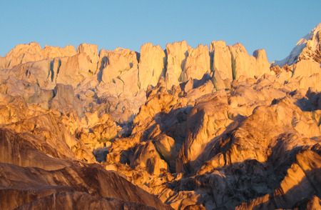 Enormous seracs (ice pillars and cliffs) on the Fox Glacier at sunset, New Zealand. Stock Photo