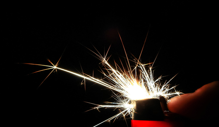 Sparks take colorful crystalline shapes as they come out of a cigarette lighter. Stockfoto