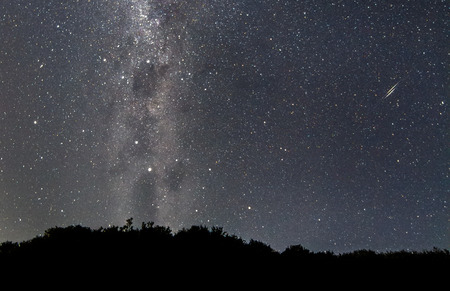 A pair of shooting stars streak across the night sky as seen from the Wilsons Promontory National Park, Victoria, Australia.