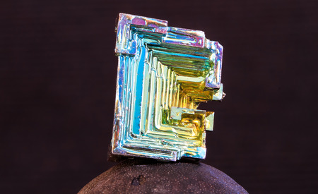 A bismuth crystal photographed up close in high detail.