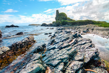 Rock layers at an intertidal zone as seen on a sunny day on the island of Islay, Scotland, UK.