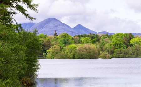 The Paps of Jura, large mountains on the island of Jura in Scotland, are seen from Loch Ballygrant on the island of Islay, Scotland.