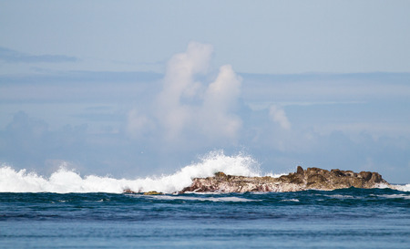 Waves crash against the rocks at Port Wemyss, Islay, Scotland. Stock fotó