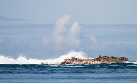 Waves crash against the rocks at Port Wemyss, Islay, Scotland. Archivio Fotografico - 120150186