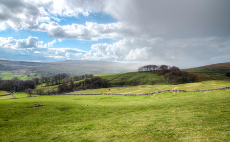 Rain clouds move in over farmland in the Peak District, England. Stock Photo