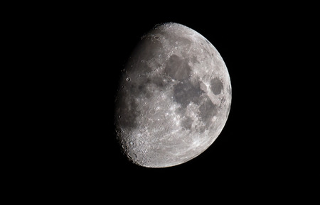 The moon is photographed at night while two thirds full and waxing. Photographed from the Peak District, England.