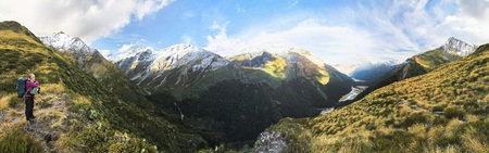 A hiker stops to admire a stunning view in the Mt. Aspiring National Park on New Zealand's south island.