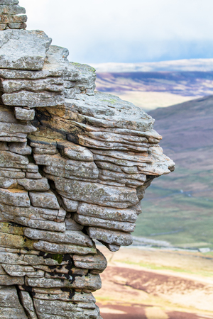 Rock layers smoothed by years of weathering are seen near the summit of Pen-y-Ghent in the Peak District, England.
