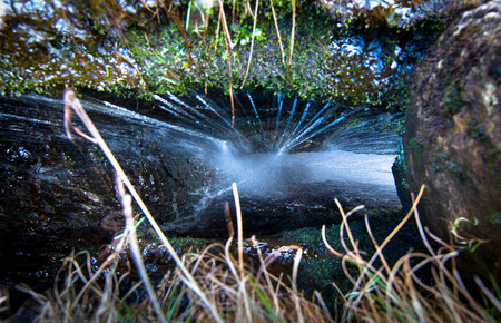 Water falls into a deep narrow hole in the rock in the Peak District, England. Archivio Fotografico - 120581713