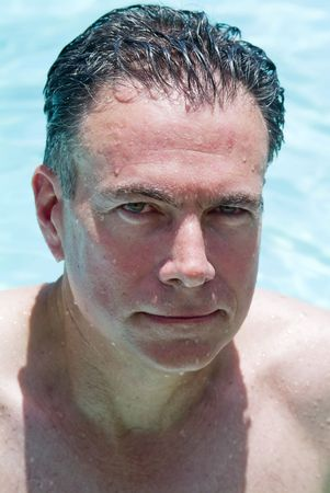 slicked: Portrait of a man in a swimming pool.