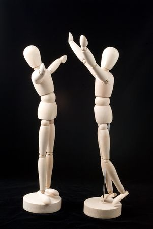 positioned: Two little mannequins positioned in a posture of joyful greeting.