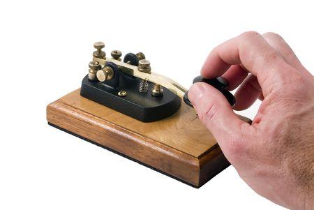 Man operating a morse code key isolated on white background Standard-Bild