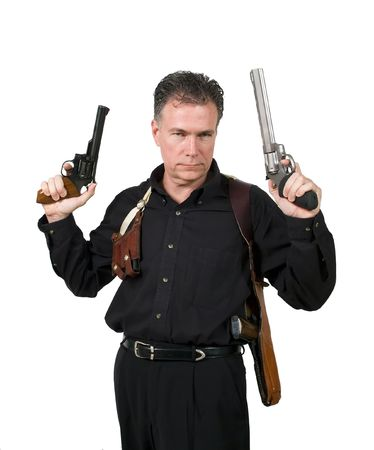 hansome: Mature, hansome, white male wearing a shoulder holster with a clip holder holding a nine millimeter automatic pistol and a 44 magnum up in the air ready for action.  Stock Photo