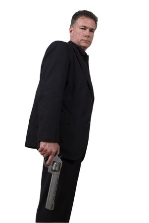suite: Mature, hansome, white male holding a 44 magnum revolver wearing a black suite isolated on a white background.