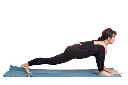 referred: A woman on a yoga mat performing a posture in yoga referred to as a lunge.
