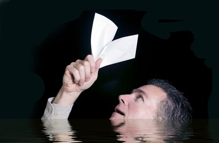 gasp: Man overwhelmed and feeling as if he is drowning in a sea of debt.  Isolated on black. Envelope left white to add text.
