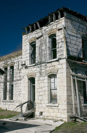 An old jail abandoned many years ago on the verge of ruin due to neglect. photo