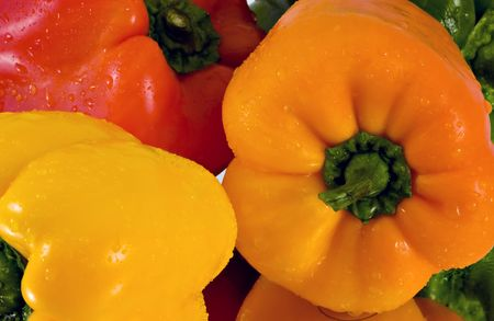sweet peppers: A group of sweet peppers on a mirror to show reflection with water droplets