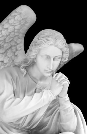 gabriel: Marble sculpture of a guardian angel isolated on a black background Stock Photo