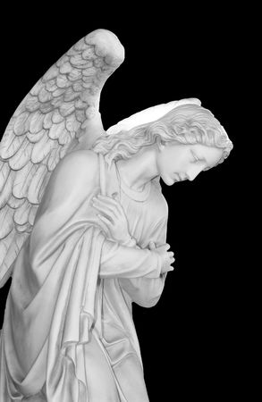 angel statue: Marble sculpture of a guardian angel isolated on a black background Stock Photo