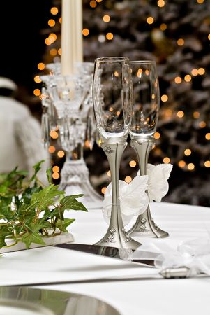gaily: Wedding champagne glasses in front of a gaily lit Christmas tree.
