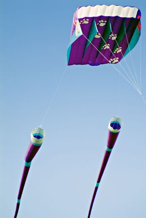 trailing: Very large colorful kite with trailing windsocks.  Stock Photo