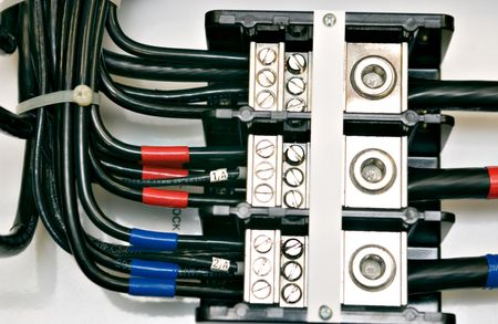 breaker: Close up shot of an electrical panel wiring with color coded cables Stock Photo