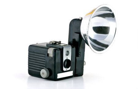 1960s camera with flash attachment.