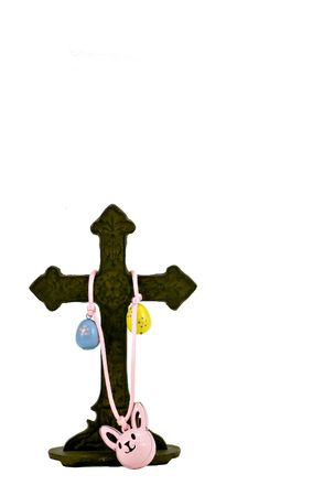 secular: Secular (Easter Eggs and Bunny Rabbit) and religious (cross) symbols intertwined in symbolic co-existance. Stock Photo