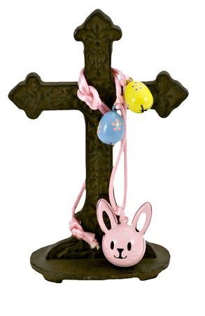 secular: Secular (Easter Eggs and Bunny Rabbit) and religious (cross) symbols intertwined in a symbiotic existence.