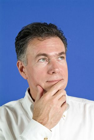Man with a quizzical facial expression, and body language indicating he is undecided.  Stock Photo