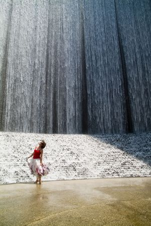 mesmerized: A woman captivated with the splendor of a remarkable manmade waterfall.