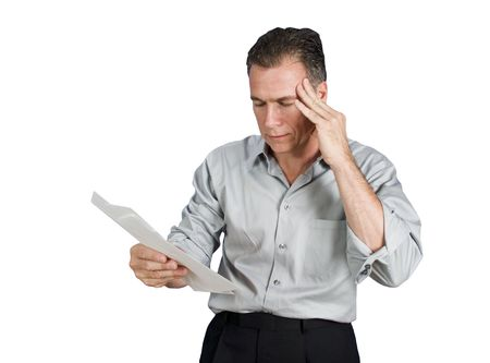 A worried man holding serveral envelopes in his hand isolated on a white background.