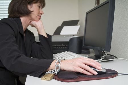 underpaid: Woman chained to her desk
